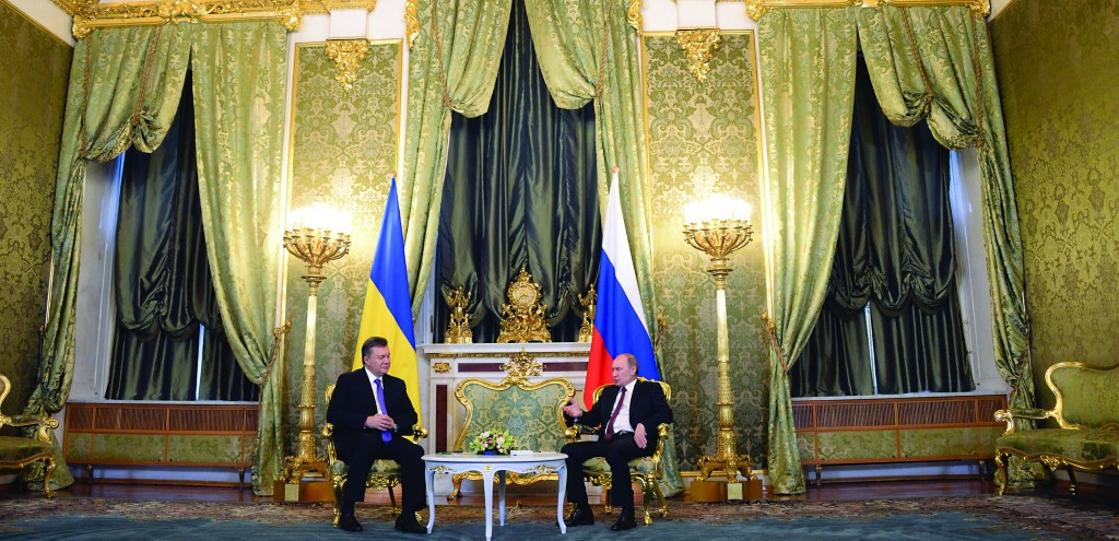 Russian President Vladimir Putin, right, and his Ukrainian counterpart Viktor Yanukovych talk during their meeting in Moscow on Tuesday. (AP Photo/Alexander Nemenov, pool)