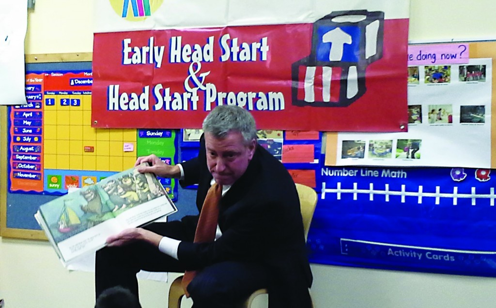 Mayor-elect Bill de Blasio reading to children of a Harlem elementary school on Tuesday, prior to releasing his pre-K panel. (Ross Barkan/Politicker)