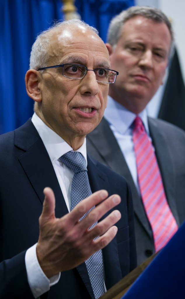 Dean Fuleihan, left, speaks Wednesday after being announced as New York City's budget director under Bill de Blasio, right. (AP Photo/Craig Ruttle)