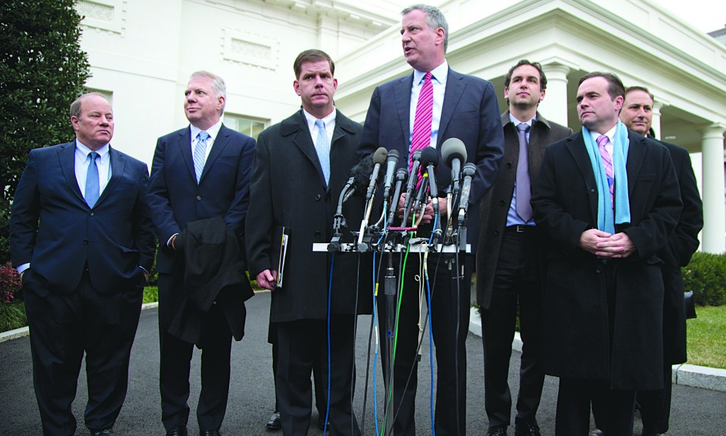 Mayor-elect Bill de Blasio, surrounded by other mayors-elect, on Friday speaks to the media outside the White House after a meeting with President Obama. (AP Photo/Carolyn Kaster)