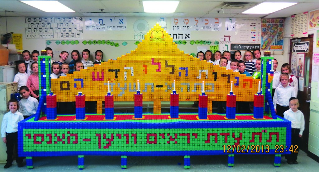A menorah, made out of 9,738 Clics, by Rabbi Klein's first-grade class at the Viener Cheder in Monsey.