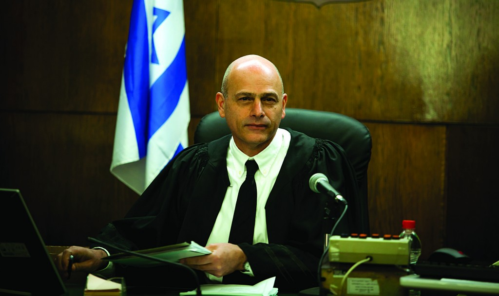 Judge Eitan Orenstein seen during a court session at the Tel Aviv District Court on Tuesday, where he approved the restructuring proposal for IDB Holding Corporation. (Eric Sultan/POOL/Flash90)