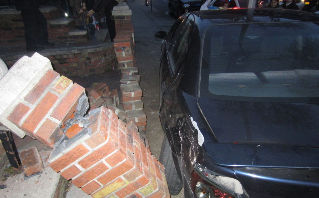 The car crashed into a brick staircase support on Ft. Hamilton Parkway and 50th Street in Boro Park, Wednesday.