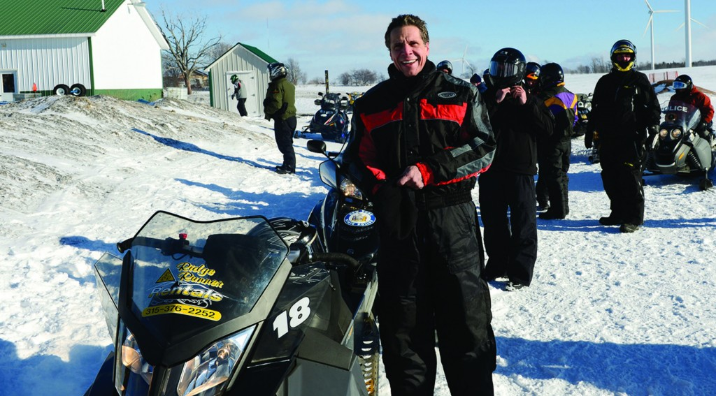 Gov. Andrew Cuomo on Monday next to a snowmobile in northern New York as part of a $4.5 million winter tourism ad campaign. (Office of the Governor)