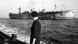 A young refugee gazes at the ship bringing Jews denied entrance to Eretz Yisrael back to Hamburg, Germany.