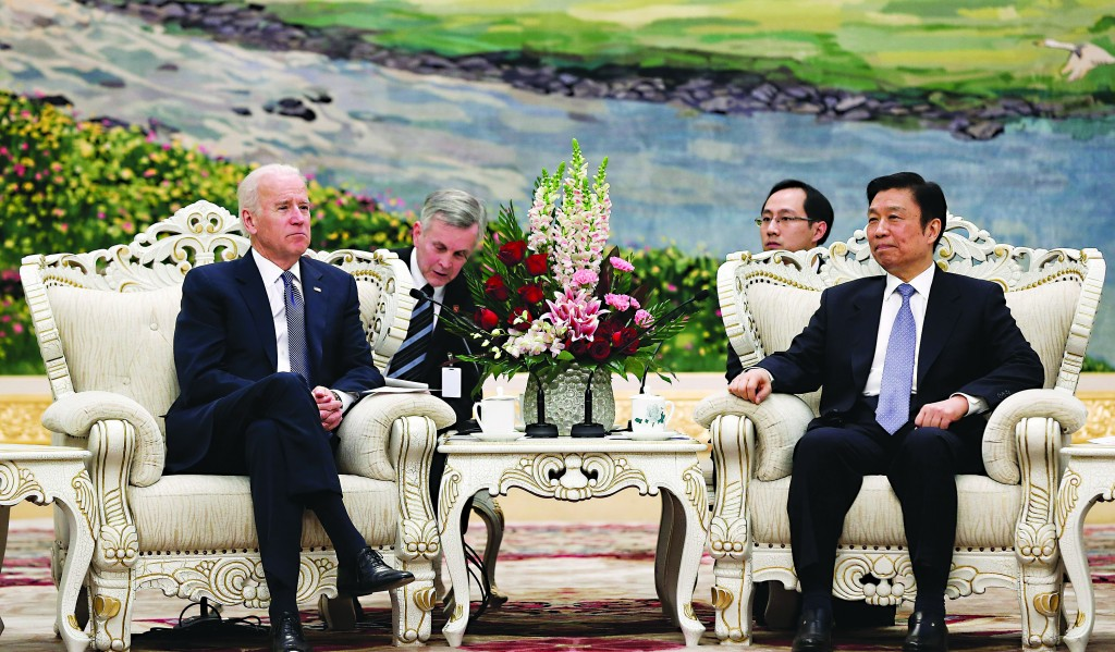 U.S. Vice President Joe Biden (L) talks with Chinese Vice President Li Yuanchao (R) at the Great Hall of the People on Wednesday, in Beijing, China. (AP Photo/Lintao Zhang, Pool)