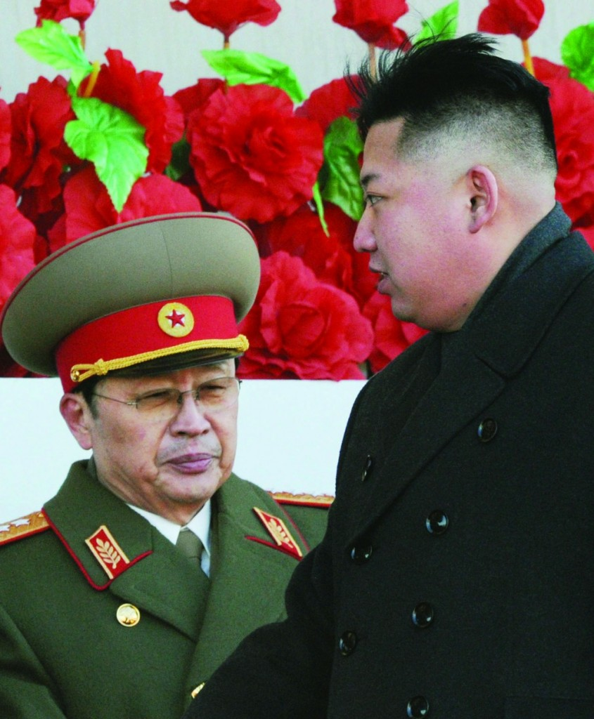 In this Feb. 16, 2012 file photo, North Korean leader Kim Jong Un walks past his uncle JangSong Thaek (L), after reviewing a parade commemorating the 70th birthday of the late Kim Jong Il, in Pyongyang, North Korea. (AP Photo/Kyodo News, File)