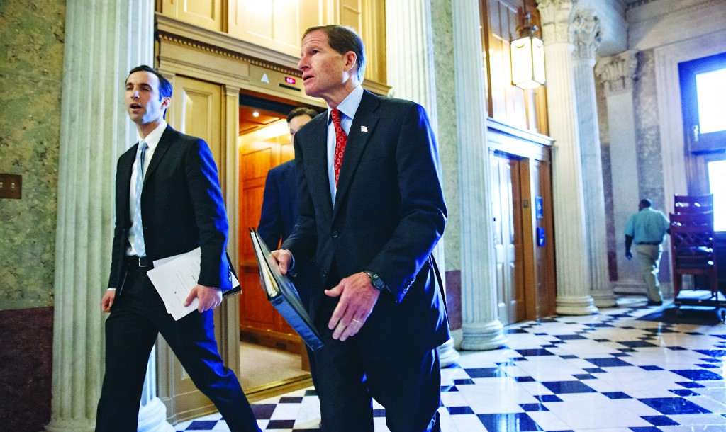 "Sen. Richard Blumenthal (D-Conn.) (R) walks to the chamber before the Senate passed a bipartisan budget pact, at the Capitol in Washington, Wednesday. The bill is designed to keep Congress from lurching from one fiscal crisis to another, and ease some effects of the automatic budget cuts, known as the  ""sequester."" (AP Photo/J. Scott Applewhite)"