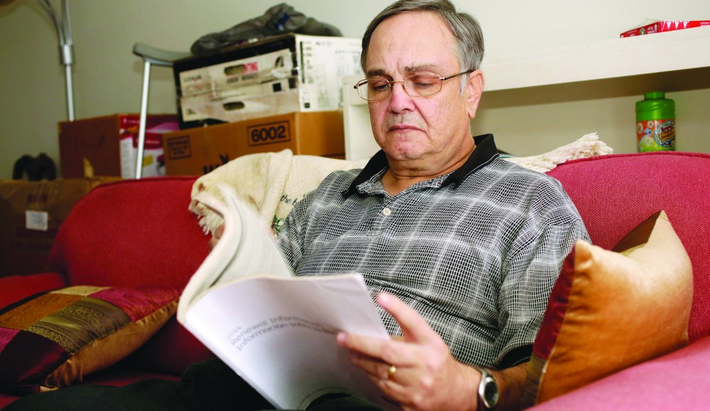 Howard Kraft looks over healthcare information in his Lincolnton, N.C. home Monday, Dec. 30. (AP Photo/Nell Redmond)
