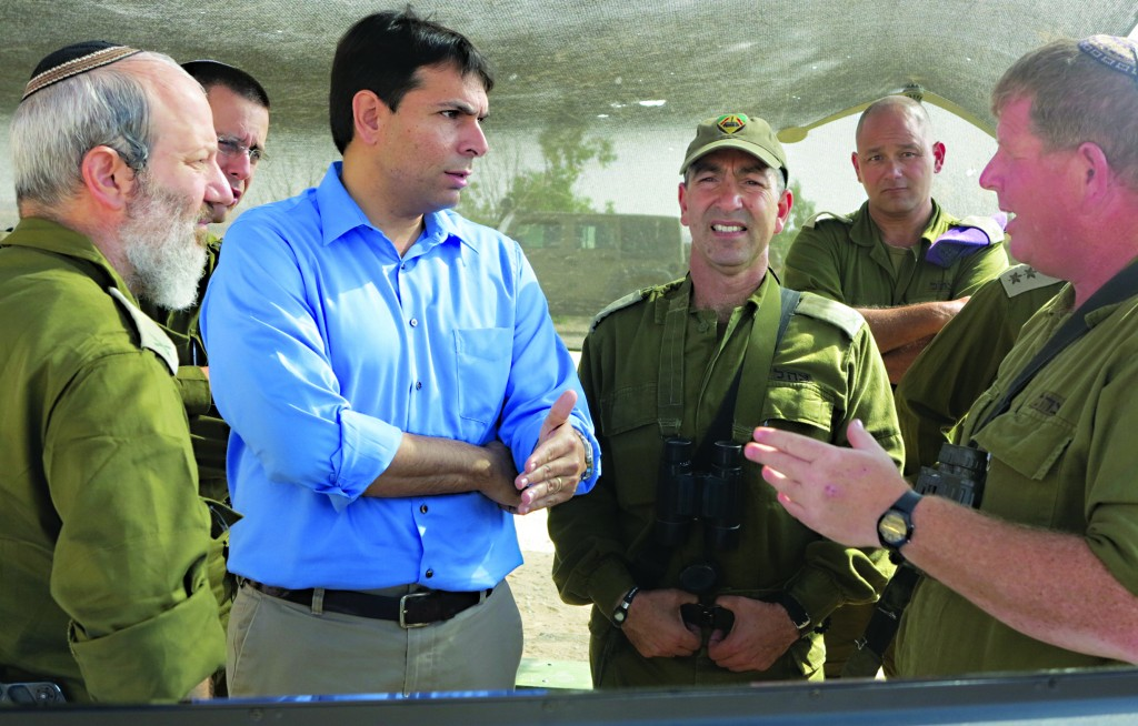 Deputy Defense Minister Danny Danon discusses the reserves drill he just observed with IDF officers.