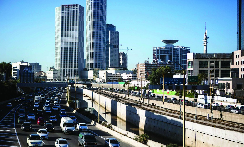 A highway in Tel Aviv. Israel plans to cut oil use in transportation by 60 percent by 2025, an aggressive target by world standards, and will tap into its newfound natural gas deposits to make it happen. (REUTERS/Nir Elias)