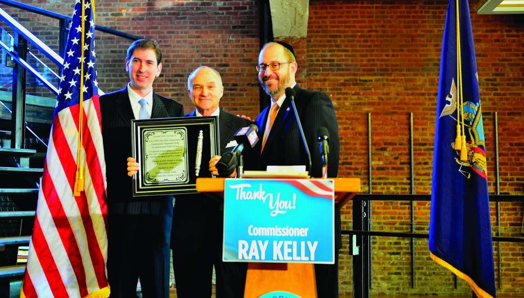 State Sen. Simcha Felder and Councilman-elect Chaim Deutsch present a silver mezuzah and plaque to NYPD Commissioner Ray Kelly during a farewell breakfast in Flatbush, Wednesday. (Office of Senator Felder)