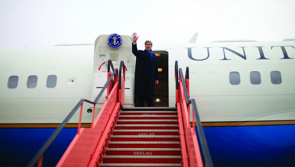 Secretary of State John Kerry boards his plane at Brussels National Airport, Wednesday, after attending the annual meeting of NATO foreign ministers, en route to Israel. (AP Photo/Pablo Martinez Monsivais, Pool)