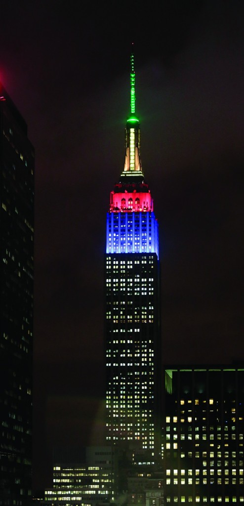 The Empire State Building climbs into the evening sky lit in the colors of theSouth African flag to observe Nelson Mandela's passing, Friday. (AP Photo/Bebeto Matthews)