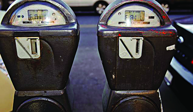 While a few years ago parking meters (top) were commonplace, they are now overtaken by munimeters (middle) and by 2015, pay by phone meters (bottom). (Flickr)