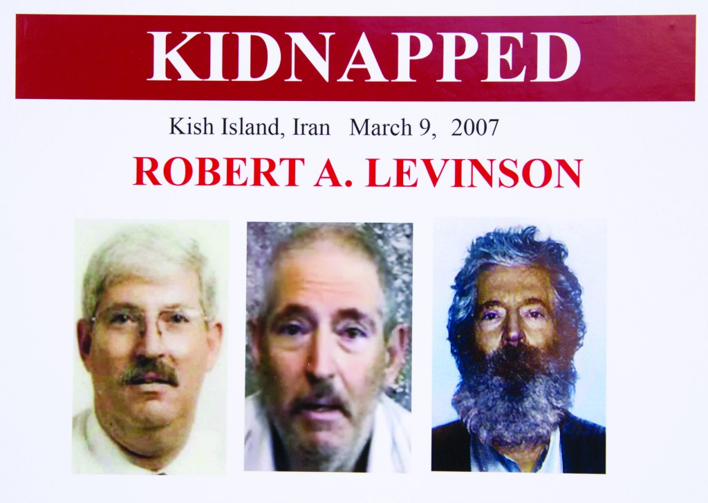 This FBI poster shows how retired FBI agent Robert Levinson (R) would look now, after 5 years in captivity, an image (C) taken from the video released by his kidnappers, and a picture before he was kidnapped (L). (AP Photo/Manuel Balce Ceneta)