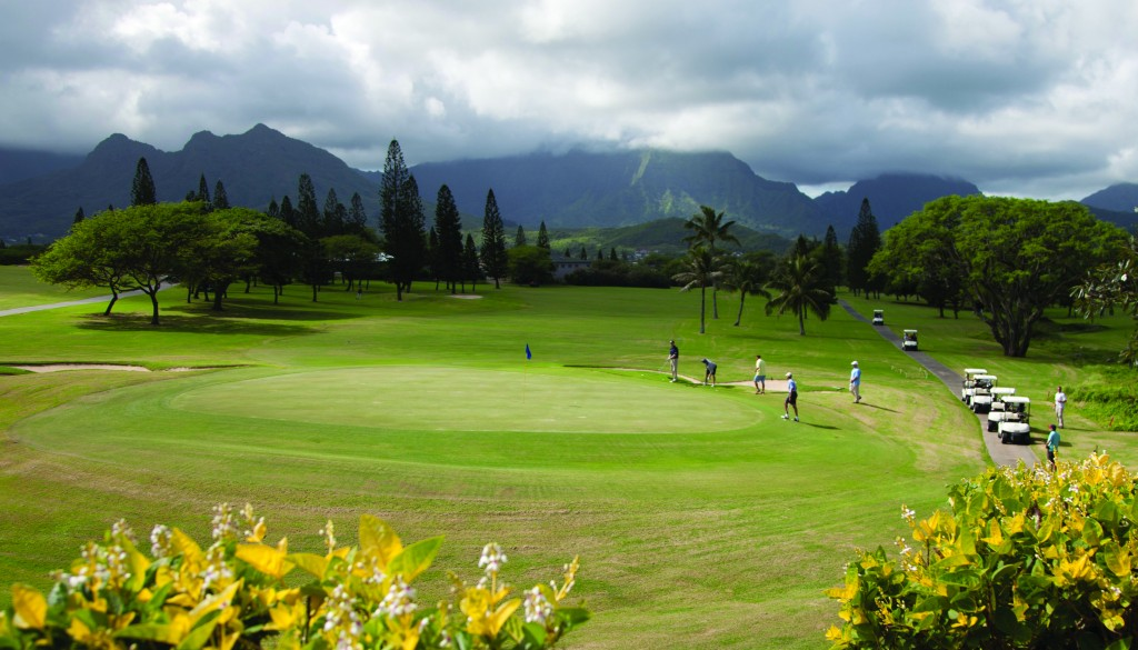 President Barack Obama, fourth from left, golfs at Mid-Pacific County Club in Kailua, Hawaii, Monday, with Marvin Nicholson, Bobby Titcomb, and Eric Whitaker. The first family is in Hawaii for their annual vacation. (AP Photo/Carolyn Kaster)