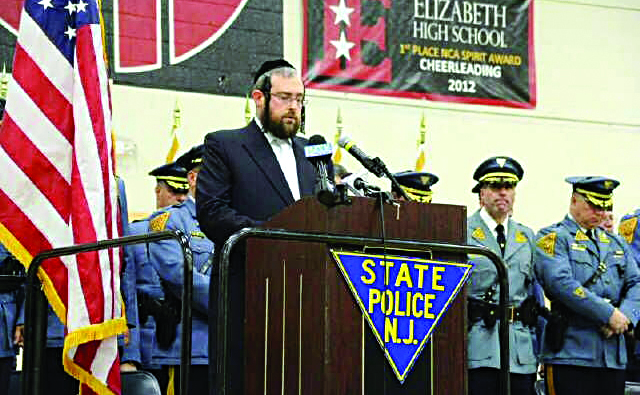 Rabbi Abe Friedman, chaplain of the New Jersey state police, on Monday addressing the 153rd class at their graduation.