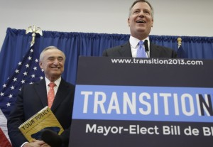 William Bratton (L) smiles as mayor-elect Bill de Blasio talks at a news conference in Red Hook, Thursday. (AP Photo)