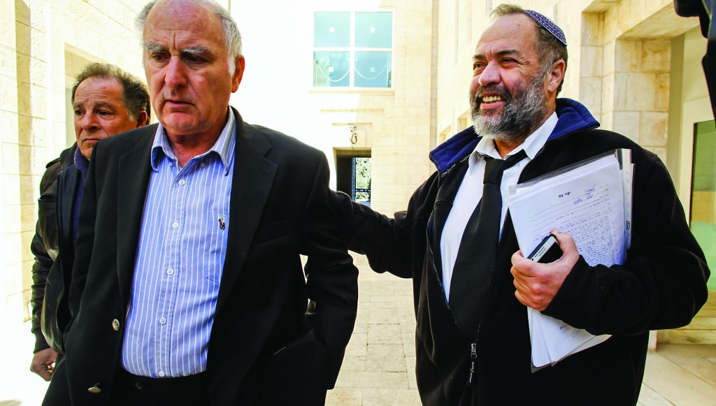 Meir Eindor, director of the Almagor Terror Victims Association and Naftali Wertzberger arrive to petition to the High Court to stop the release of Palestinian prisoners on Monday. (FLASH90 )
