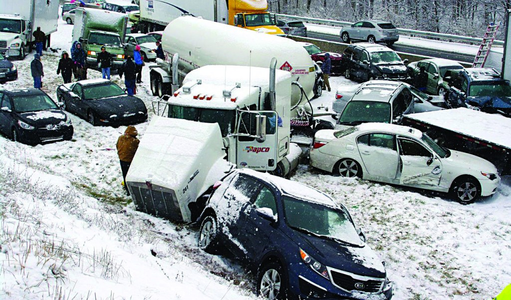 Portions of highways were shut down for many hours Thursday in snowy eastern Pennsylvania after chain-reaction pileups ensnared dozens of vehicles on slippery roads. No deaths have been reported. Pennsylvania Turnpike officials said Thursday that 35 vehicles piled up in related accidents, blocking westbound lanes and causing a 4-mile backup about 50 miles west of Philadelphia, between the Morgantown and Reading exits in Berks County. (AP Photo/David C. Ronk)