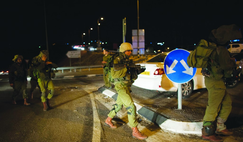 The scene where an Israeli police officer was stabbed in the back, near Adam, north of Yerushalayim on Monday. (Yonatan Sindel/Flash90)