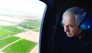 Prime Minister Binyamin Netanyahu in a helicopter over southern Israel a few days ago. (Kobi Gideon /GPO/FLASH90)