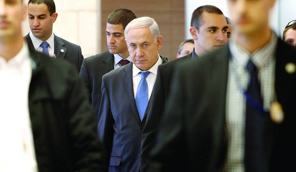 Israeli Prime Minister Binyamin Netanyahu, surrounded by security, as he arrives for a Likud-Beitenu faction in the Knesset this week. (Miriam Alster/FLASH90)