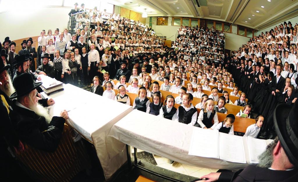 Erlauer Rebbe, shlita, distributing Chanukah gelt to talmidim of the Erlauer cheder. (JDN)