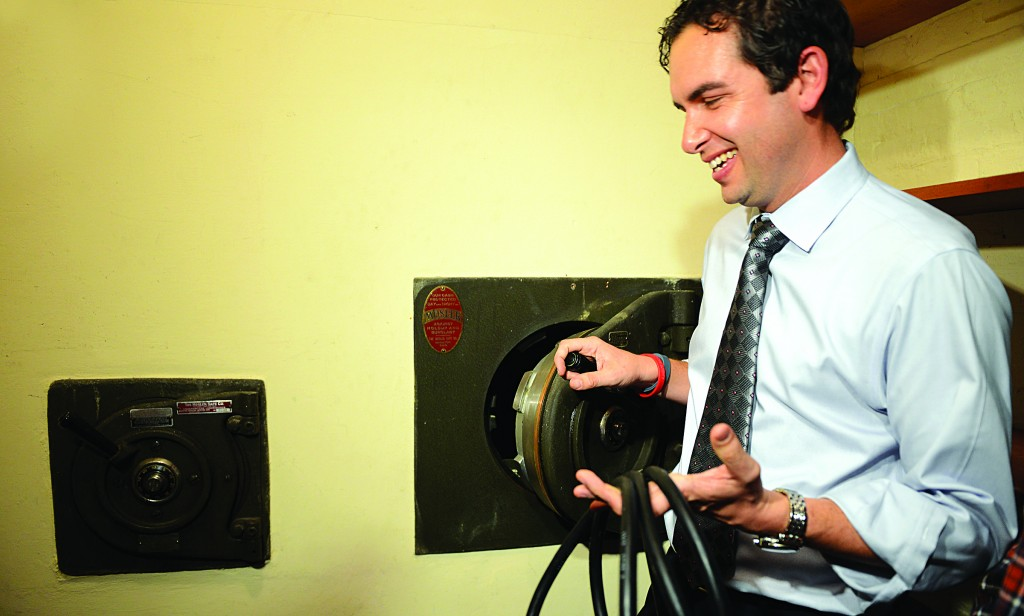 Mayor Steve Fulop on Tuesday holds an extension cord that was found inside the smaller of the two mystery safes inside a vault at Jersey City's city hall. (AP Photo/The Jersey Journal, Reena Rose Sibayan)
