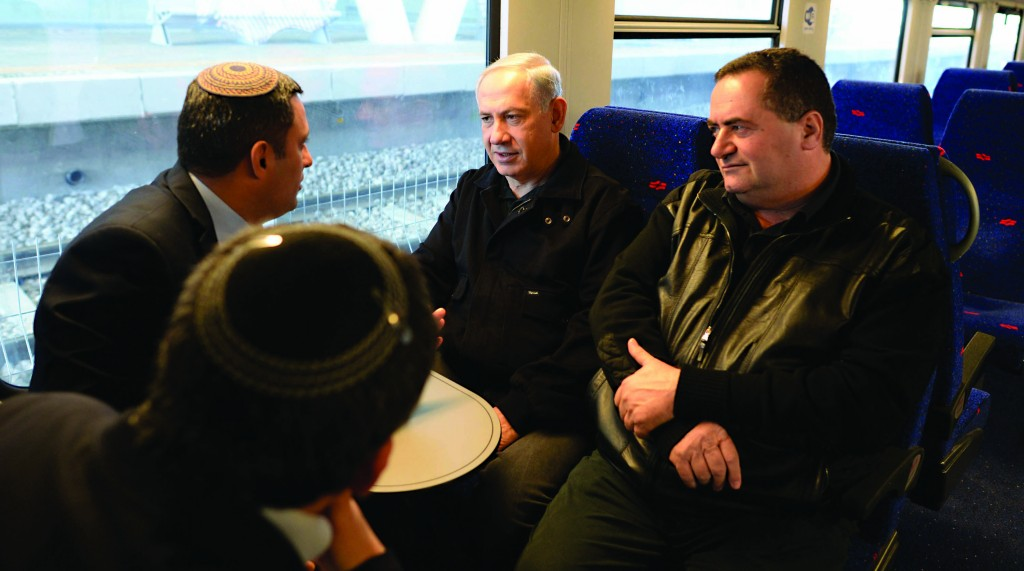Israeli Prime Minister Binyamin Netanyahu and Minister of Transportation Yisrael Katz seen aboard a train in Sderot, where they inaugurated a new train station. (Kobi Gideon /GPO/FLASH90)
