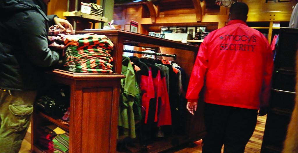 A security agent walks the floors at Macy's last week. (AP Photo/Bebeto Matthews)