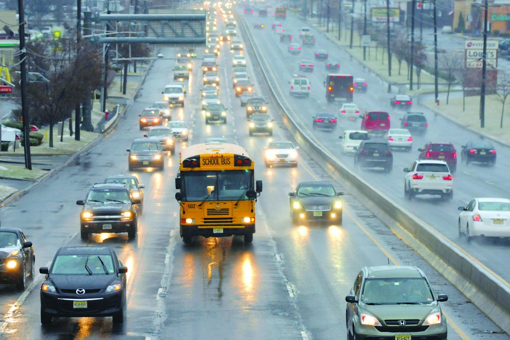 Commuters, who awoke to wet and icy conditions, travel on Route 4 east in Paramus, NJ, Monday. (AP Photos)