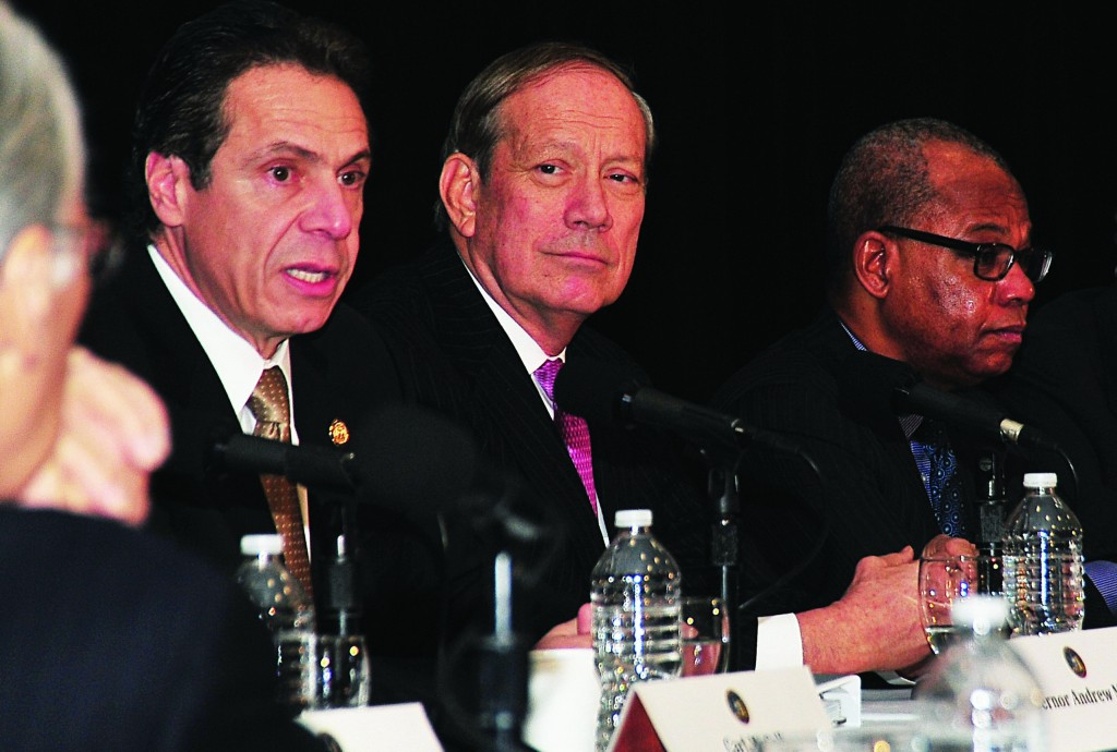 Gov. Andrew Cuomo (left) accepts the final report of the Tax Relief Commission from its co-chairs, former Gov. George Pataki (center) and former State Comptroller H. Carl McCall (right).