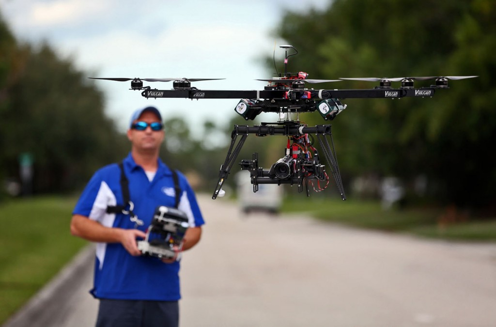 ReadyHeli.com technician and sales agent Brett Strand operates his own personal octacopter drone in Jupiter, Fla., Dec. 4, 2013. (Richard Graulich/Palm Beach Post/MCT)