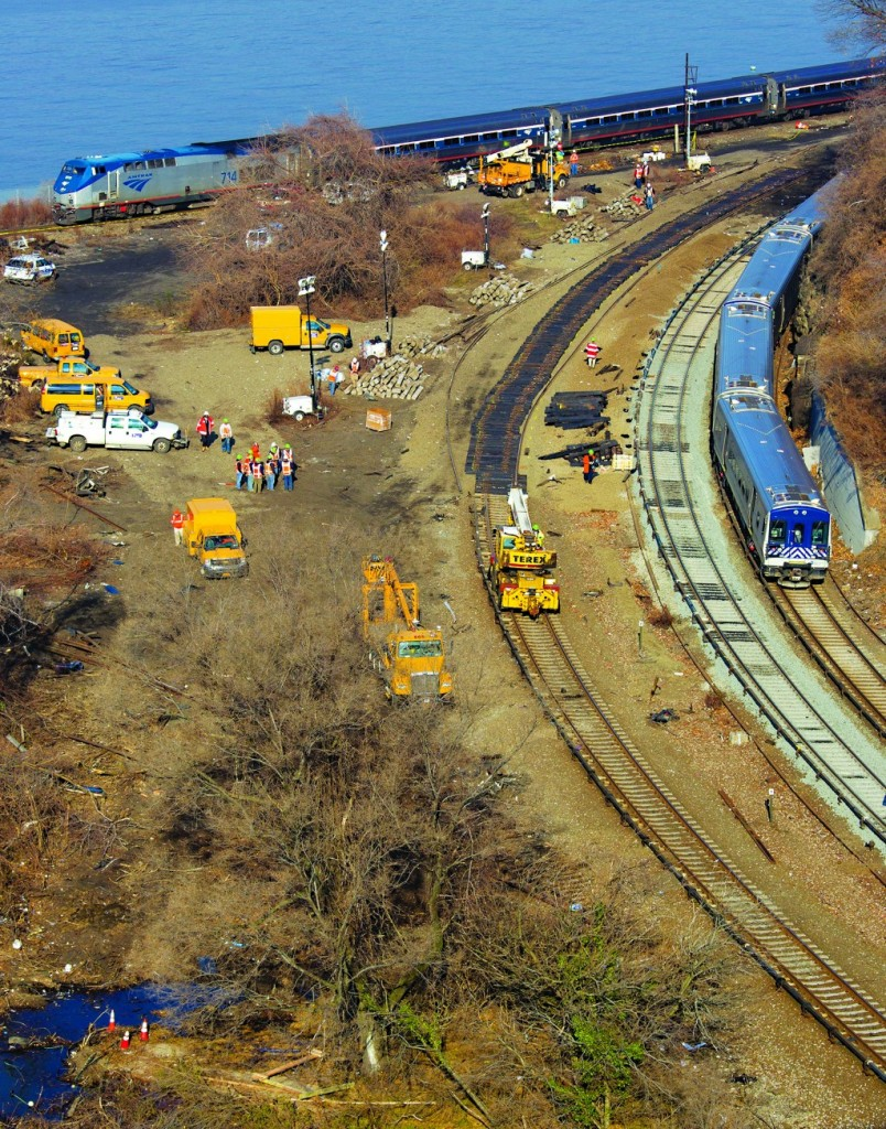 A train rounds a sharp curve in the Bronx on Wednesday, as crews rebuild the damaged track where a fatal derailment disrupted service on Sunday. (AP Photo/Craig Ruttle)