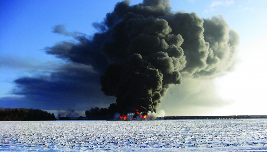 This photo provided by Cass County Commissioner Ken Pawluk shows a train derailment and fire west of Casselton, N.D., Monday. (AP Photo/Ken Pawluk)