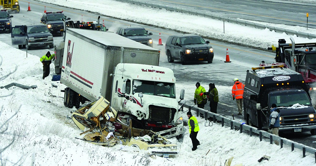 Emergency personnel on Tuesday at the scene of a crash where a state trooper was struck and killed by a tractor-trailer on the Thruway in Amsterdam, NY. (AP Photo/The Albany Times Union, Skip Dickstein)