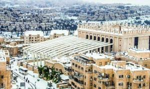 A partial view of the central Belzer beis medrash and surrounding streets covered by snow,  in Kiryas Belz, Yerushalayim.