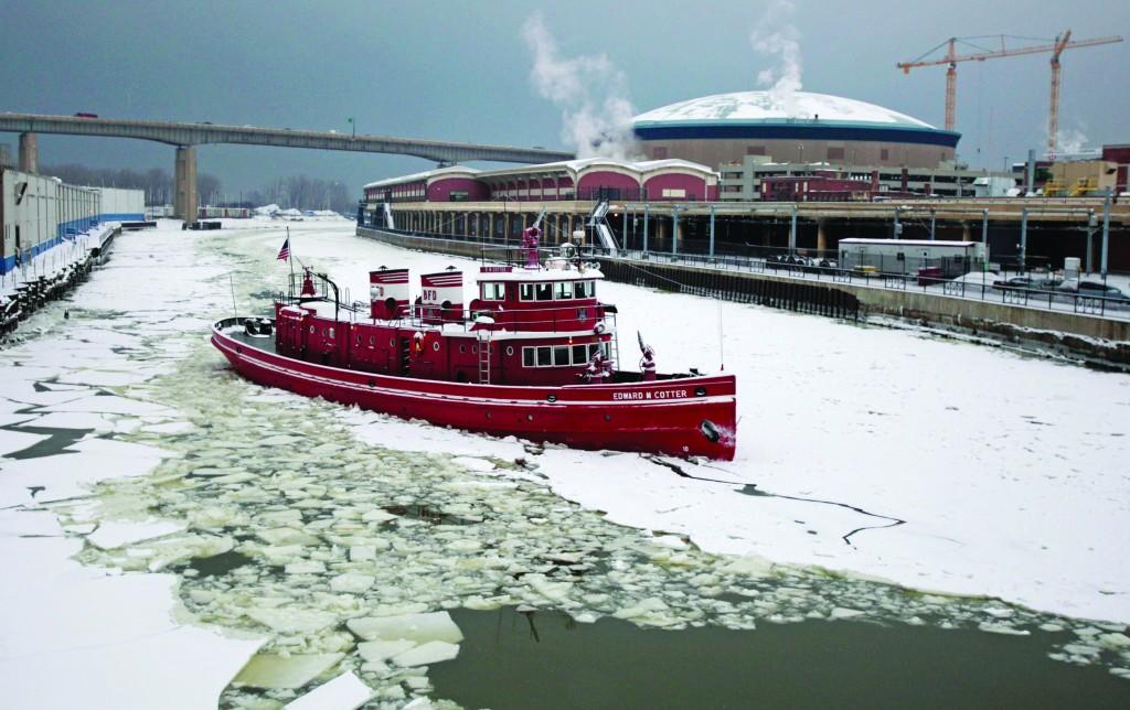 The Buffalo Fire Department's fireboat breaks through the ice in the Buffalo River Tuesday. (AP Photo/The Buffalo News, Derek Gee)