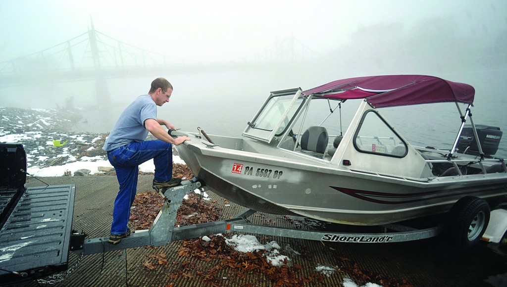 Scott Moser puts his boat in the Delaware River from the boat launch in Phillipsburg, N.J. as heavy fog surrounds the area on Sunday. (AP Photo/The Express-Times, Matt Smith)