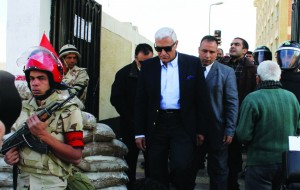 Egypt's former intelligence chief Murad Muwafi leaves after casting his vote in a referendum on the new Egyptian constitution at a polling station in Cairo. (REUTERS/Al Youm Al Saabi Newspaper)