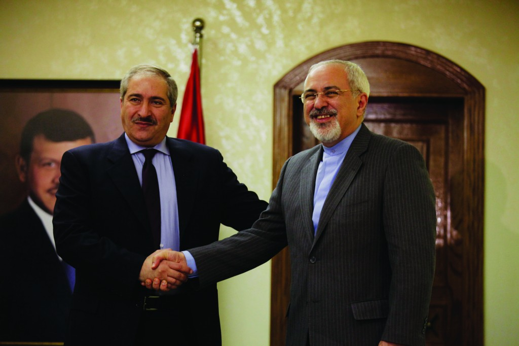 Iranian Foreign Minister Mohammad Javad Zarif, right, shakes hands with his Jordanian counterpart Nasser Judeh in Amman, Jordan, Tuesday. Zarif visits Jordan as part of his regional tour of the Middle East countries including Iraq, Kuwait, Lebanon, Oman, Qatar and United Arab Emirates. (AP Photo/Mohammad Hannon, Pool)