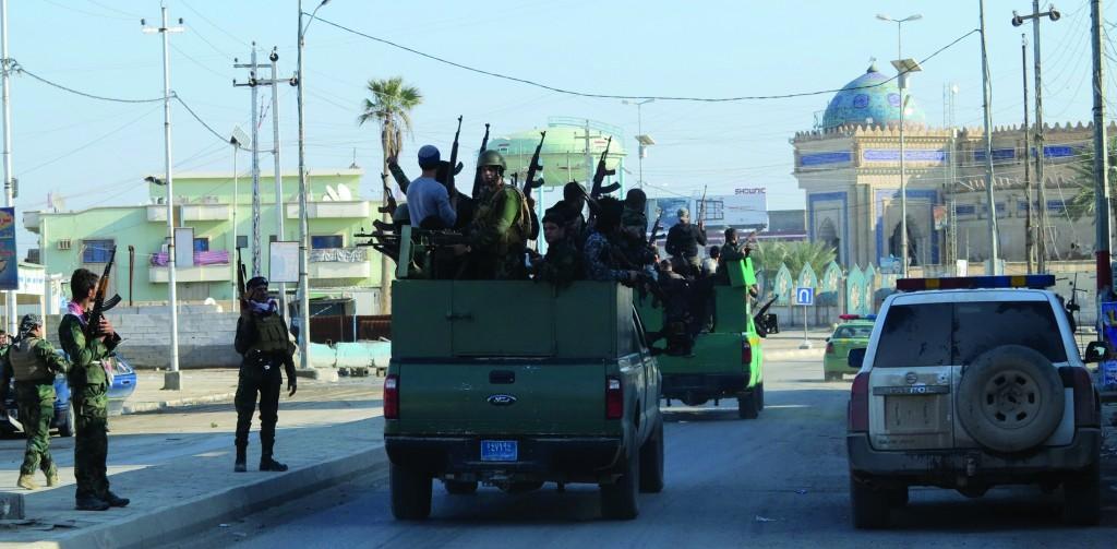 Iraqi security forces and Iraqi Sunni Muslim tribesmen deploy during a patrol in Ramadi Sunday. (REUTERS/Ali al-Mashhadani)