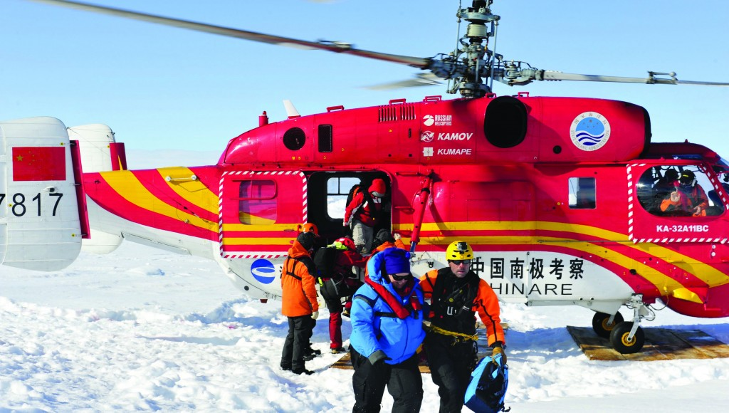 The first group of passengers of the trapped Russian ship MV Akademik Shokalskiy arrive at a safe surface off the Antarctic Thursday. (AP Photo/Xinhua, Zhang Jiansong)