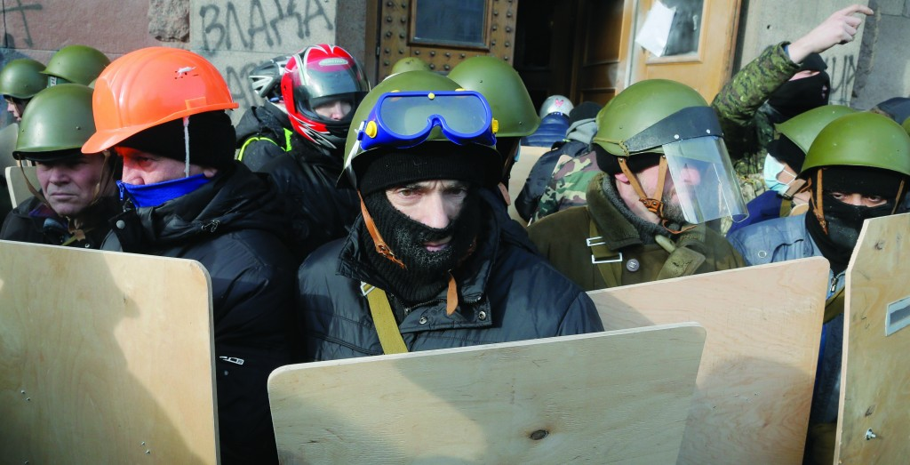 Protesters armed with plywood shields block the entry to the Agriculture Ministry in Kiev, Ukraine, Wednesday. (AP Photo/Efrem Lukatsky)