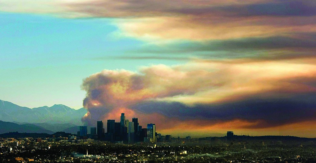 A large fire plume rises above the downtown skyline from the fast-growing Colby fire in Southern California from the Baldwin Hills Scenic Overlook Thursday morning. (Al Seib/Los Angeles Times/MCT)