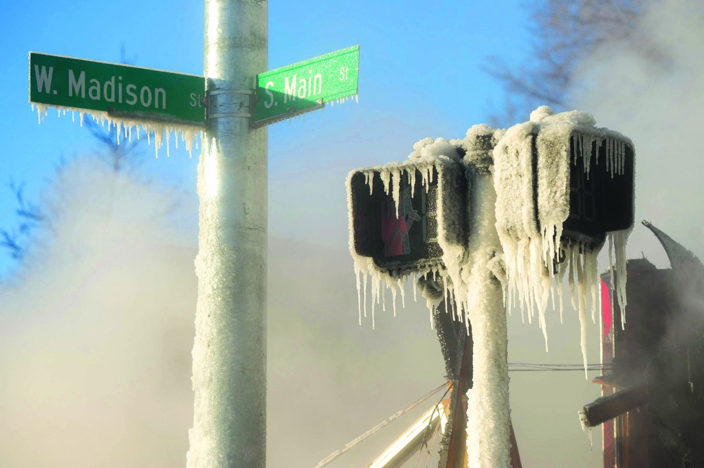 Ann Arbor, Michigan  Ice covers the street and cross walk sign as firefighters work to put out a fire that engulfed a pizza shop. Firefighters worked for several hours in temperatures that dipped to 15 degrees below zero to extinguish the blaze.