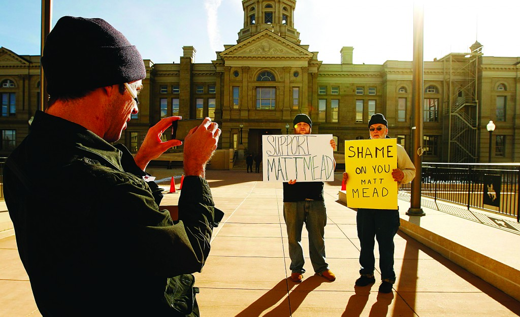 Wyoming Gov. Matt Mead supporter Lee Welch, (L), and opponent Dave Cromley during a rally on Jan. 9, in Cheyenne, Wyo. One organizer estimated about 200 people gathered at the Herschler Building to protest Mead's refusal to use Affordable Care Act money to expand Wyoming's Medicaid coverage. (AP Photo/Casper Star-Tribune, Dan Cepeda)