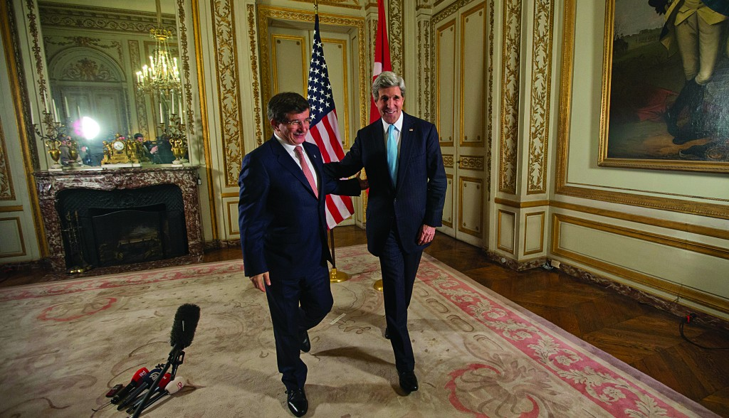 Secretary of State John Kerry, right, walks out with Turkish Foreign Minister Ahmet Davutoglu, after addressing members of the media at the U.S. Ambassadors residence in Paris, France, Sunday. (AP Photo/Pablo Martinez Monsivais, Pool)